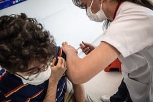 A nurse administers a BioNTech vaccine dose to an individual during the Covid-19 vaccination operation at Ankara City Hospital.