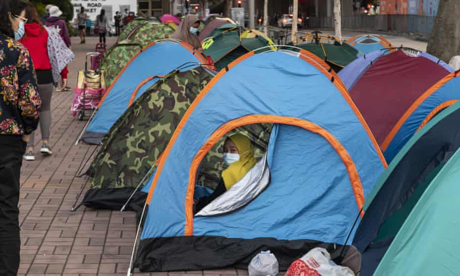 Domestic helpers are seen inside tents in order to remain socially distanced in Hong Kong in December.