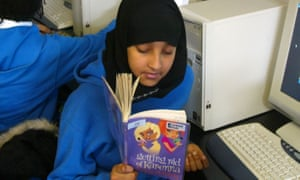 A year 7 student engrossed in a book
