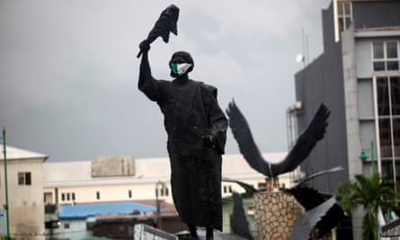A statue of Efunroye Tinubu with a face mask at Tunubu Square in central Lagos, Nigeria, 17 June 2020