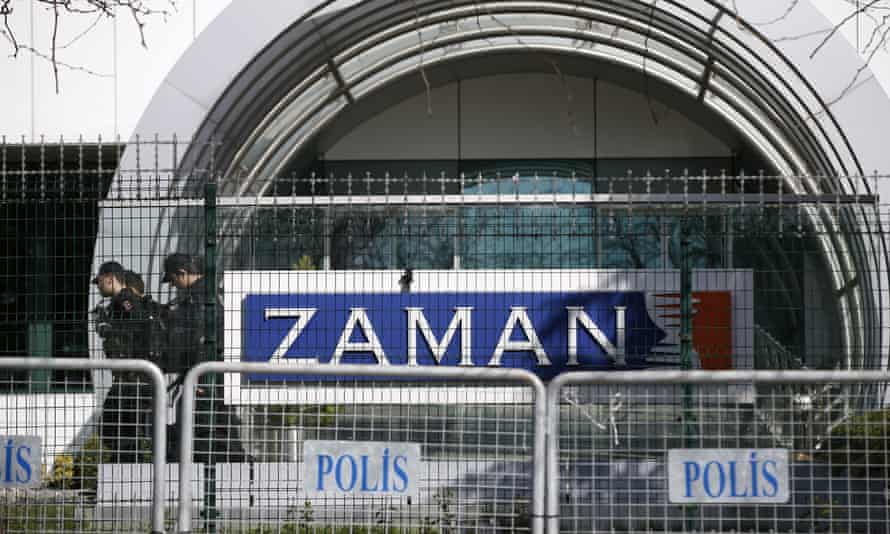 Police at the headquarters of Zaman in Istanbul