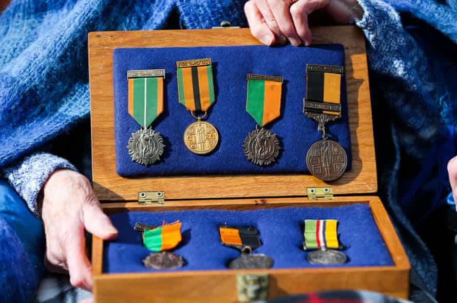 Sheila O'Leary, 94, from Clontarf, whose father Thomas Byrne fought in the GPO in 1916, holds a box of his medals on O'Connell Street as she awaits the parade