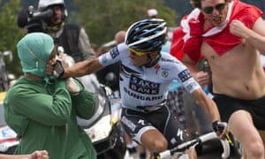 Alberto Contador punches a fan dressed up as a doctor during the 2011 Tour.