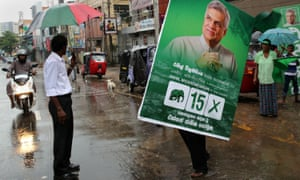 A supporter holds a poster of Ranil Wickremesinghe in Colombo. The prime minister's UNP doubled its representation to 106 seats, seven short of a majority.