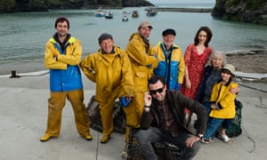 Daniel Mays, centre front, and Tuppence Middleton, third from right, in Fisherman's Friends.