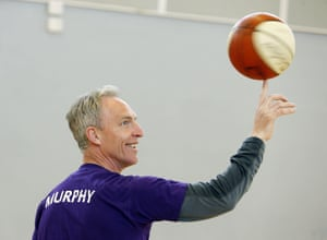 Jim Murphy plays basketball on the election campaign trail.