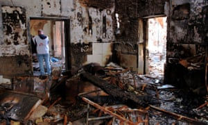 A Médecins Sans Frontières staff member inspects the damage at an MSF hospital in Kunduz, Afghanistan, following a US air strike.