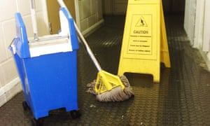 Office cleaning equipment: mop and bucket.