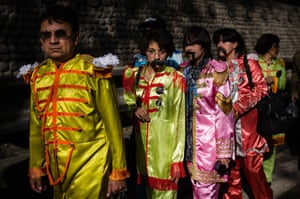 People dressed as members of the Beatles gather at Chapultepec park in Mexico City during an attempt to set a new Guinness World Record for the highest number of people dressed as The Beatles