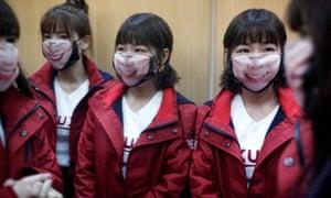 Cheerleaders wearing face masks