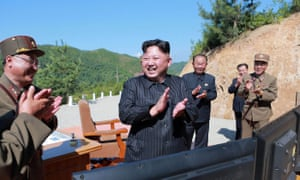 Kim Jong-un and North Korean officials celebrate the launch last November of a Hwasong-14 missile that landed in the Sea of Japan.