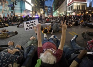 Protestors lay in the street at Herald Square in New York.