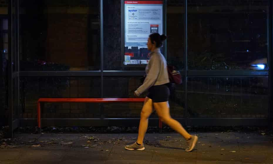 A woman walking alone past a bus stop on Poynders Road in Clapham, south London, close to where Sarah Everard was abducted by ex-police officer Wayne Couzens.