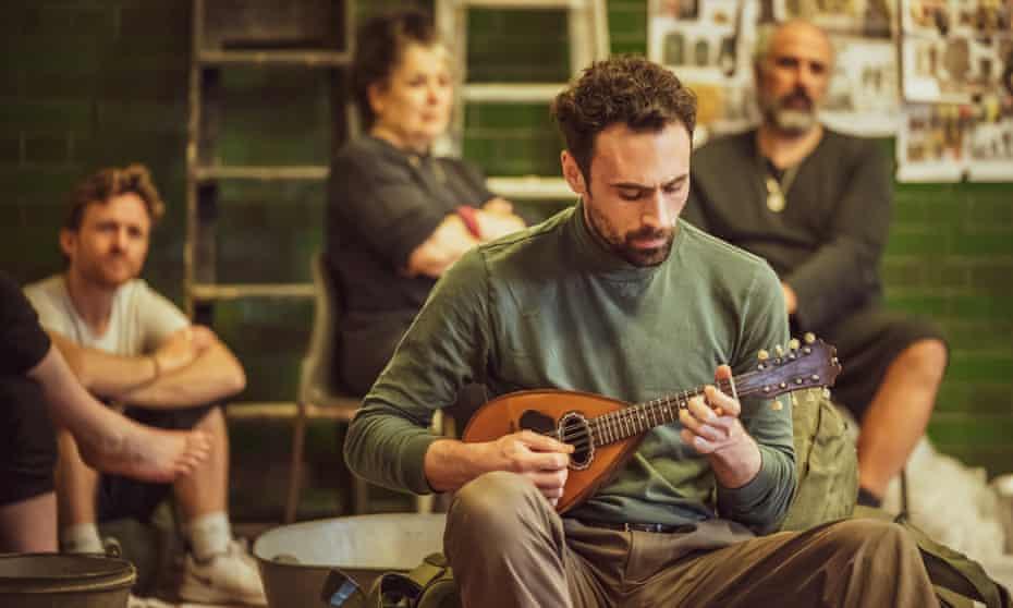 Strumming his pain with his fingers ... Alex Mugnaioni in rehearsals for Captain Corelli's Mandolin.