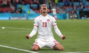 Denmark's Yussuf Poulsen celebrates scoring their second goal.