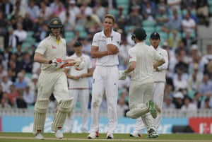 A Frustrated Stuart Broad looks on as Voges and Smith takes more runs.