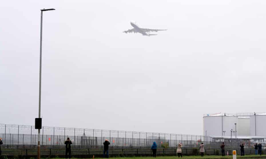A British Airways Boeing 747 aircraft makes a flypast over London Heathrow airport