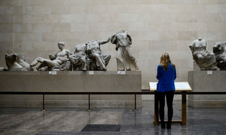 A woman looks at the Parthenon Marbles on show at the British Museum in London