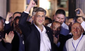 Andrej Plenkovic celebrates with HDZ party members after declaring victory in Zagreb