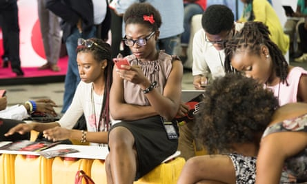 Young Nigerian women using mobile phones