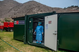 A specialist stands in a mobile unit set up by the Peruvian Ministry of Health as a preventive measure if a case of the COVID-19 virus emerges, at Lima's Hipolito Unanue hospital. Peru currently has no record of Covid-19 cases.