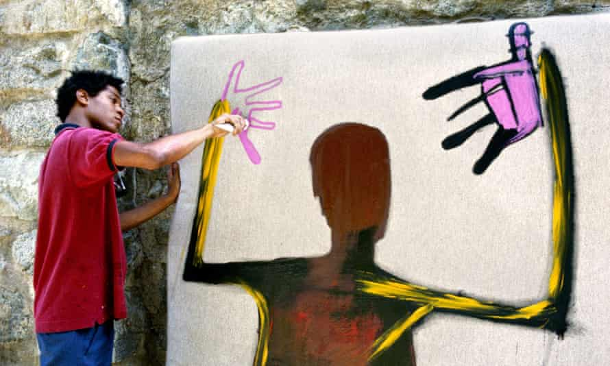 Jean-Michel Basquiat painting in 1983.