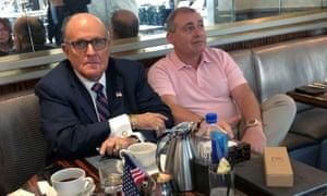 Donald Trump's personal lawyer Rudy Giuliani has coffee with Ukrainian-American businessman Lev Parnas at the Trump International Hotel in Washington, on Friday.
