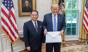 Trump with the big envelope given to him by Kim Yong-chol.