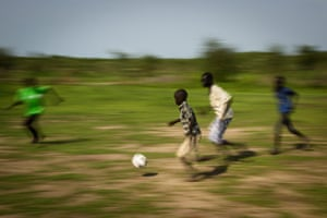 Children play football at the Pibor youth centre.
