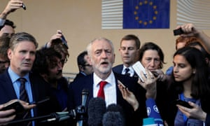 Jeremy Corbyn and Keir Starmer (L) talk to reporters after meeting Michel Barnier and Martin Selmayr at the European commission.