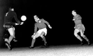 Benfica's goalkeeper, Pereira, collects the ball as Ferenc Puskas, right, looks to steal in during the European Cup final in which the Real Madrid player scored a hat-trick.