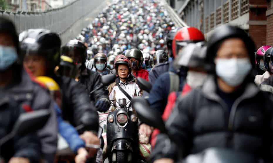 Commuters in Taipei wear face masks. Taiwan has been one of the most successful countries in controlling the coronavirus epidemic.