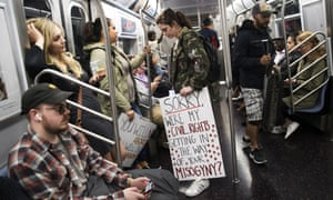 Demonstrators carry their signs on a subway train after joining a protest against abortion bans in New York City, U.S.