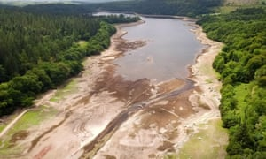 The dried up bed of the Burrator reservoir, Dartmoor, Devon, as the heatwave continues across the UK.