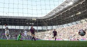 Lyon's Dzsenifer Marozsan (left) scores the opening goal.