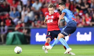 Adelaide's Scott Galloway tries to close down Paulo Retre of Sydney FC