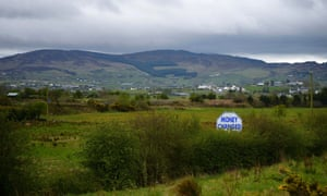 A sign advertising exchange services for sterling and euros in Newry, Northern Ireland, in May.