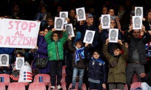 Napoli fans hold up photographs and a banner in support of Kalidou Koulibaly after the Senegalese defender was racially abused in December 2018.