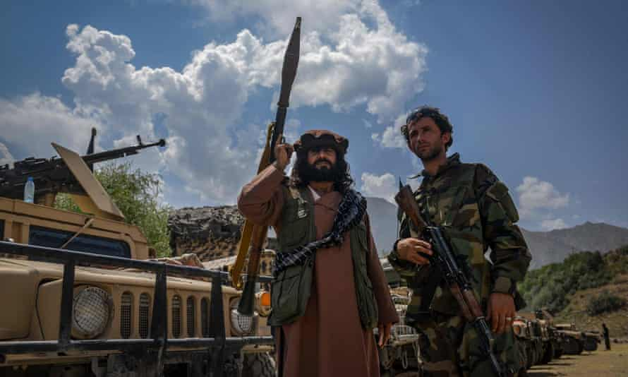 Afghan men supporting the security forces against the Taliban stand with their weapons in Bazarak, Panjshir province.