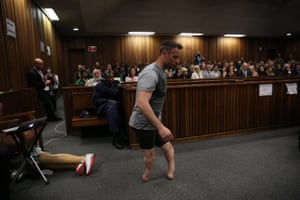 The Paralympic gold medalist Oscar Pistorius walks across the courtroom without his prosthetic legs during the third day of the re-sentencing hearing for the 2013 murder of his girlfriend Reeva Steenkamp, at Pretoria high court, South Africa. 15 June 2016.