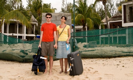 Tourist Couple at Destroyed Resort