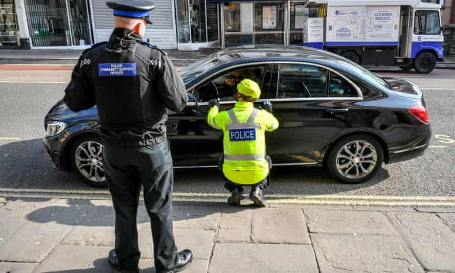 Police stop motorists in Bristol for random checks on essential travel during the coronavirus lockdown, 27 March 2020