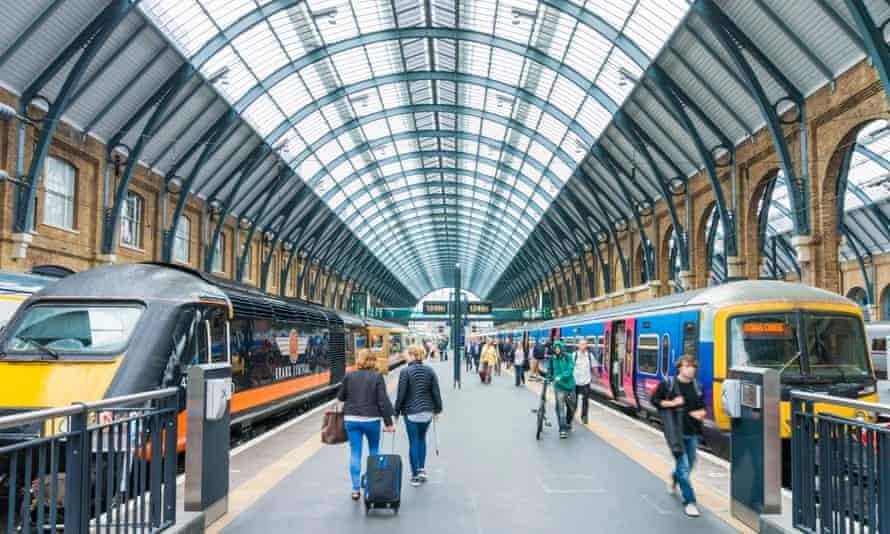 Commuters board trains in London.