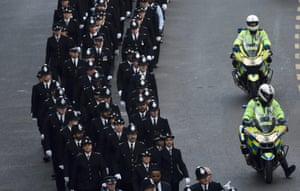 Police officers arrive for the funeral