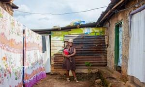 Nana  Kabogere outside her house in Namuwongo