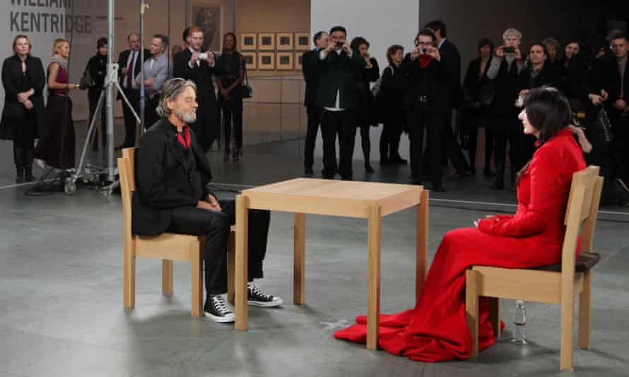 Ulay and Marina sit opposite each other in 2010's The Artist is Present.