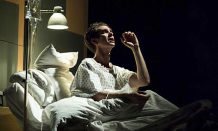 Andrew Garfield plays the lead during a hospital scene in the Angels in America production at Britain's National Theatre in London.