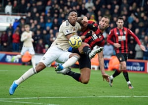 Bournemouth's Steve Cook is challenged by Manchester United's Anthony Martial at the Vitality Stadium. Bournemouth held onto their first half lead to win the game 1-0.