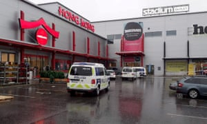 Police vans in front of the shopping centre where the Savo Vocational College is located in Kuopio, Finland, following an attack