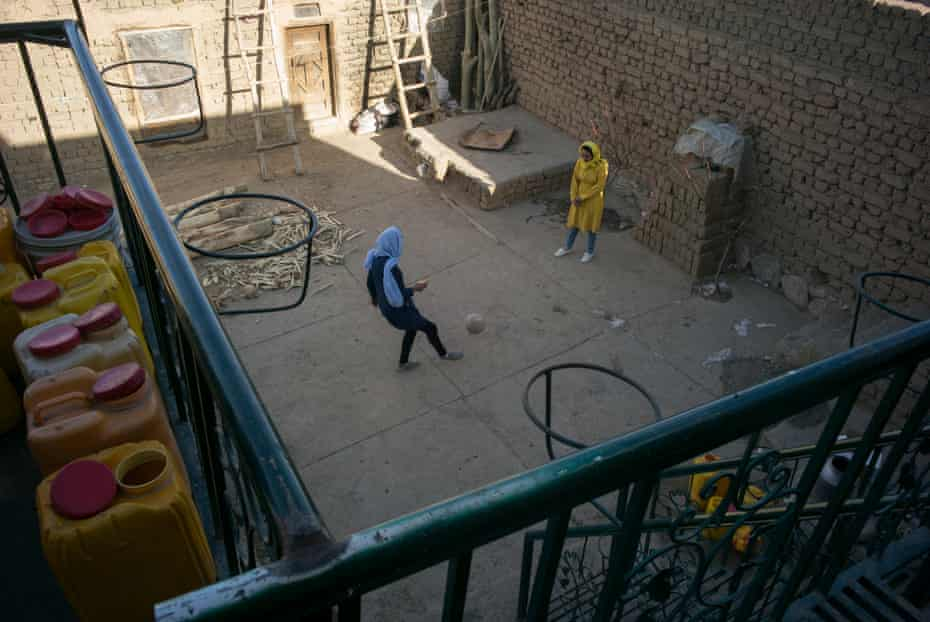 Best friends Nazira and Tayeba play football with each other at Taybea's home.